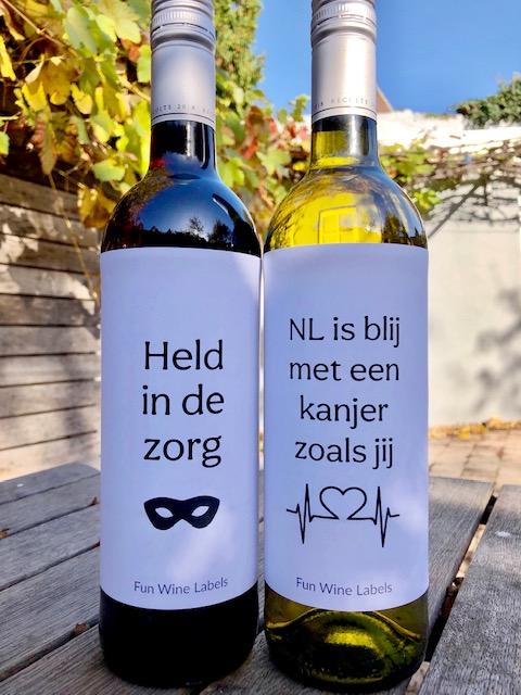 wijnetiket zorg held en zorg kanjer op een fles wijn